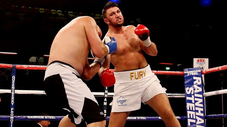 Fury will never step in to the ring to face cousin Hughie Fury (R)