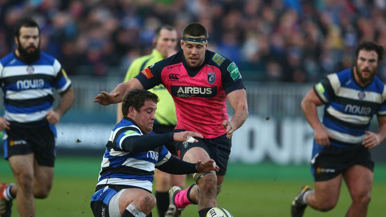 James Down (centre, red shirt) charges through on the ball for Cardiff Blues during a match against Bath