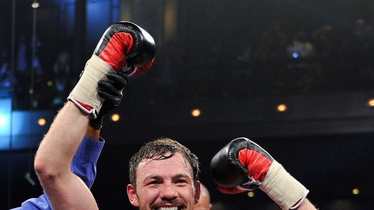 Andy Lee celebrates after stopping Matt Korobov to win the world title