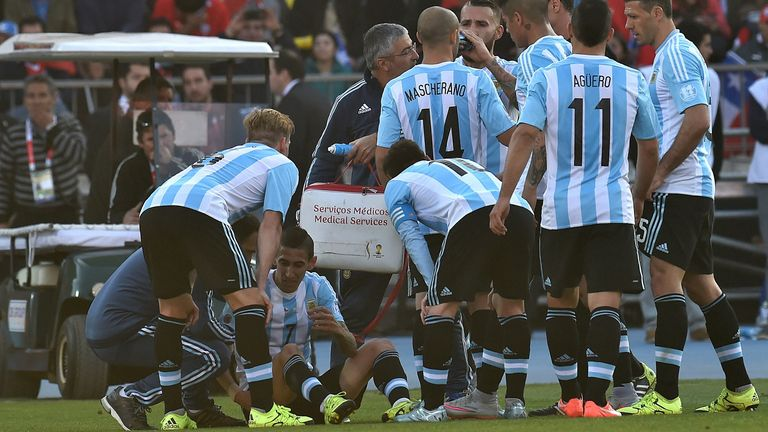 Angel Di Maria: Sits injured on the ground in the first half