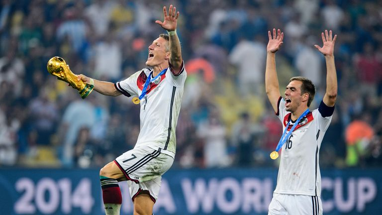 Schweinsteiger (left) and Philipp Lahm celebrate their World Cup triumph