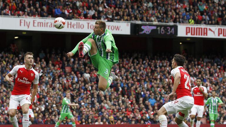 Wolfsburg striker Nicklas Bendtner jumps to control the ball inside the area