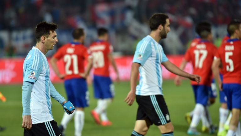 Lionel Messi and Gonzalo Higuain walk off at full-time
