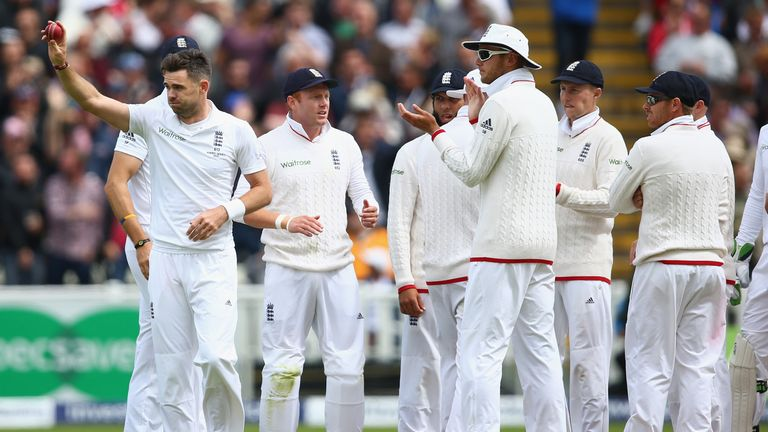 James Anderson raises the match ball after taking his fifth wicket