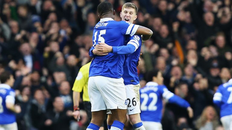 John Stones and former Everton team-mate Sylvain Distin celebrate last season