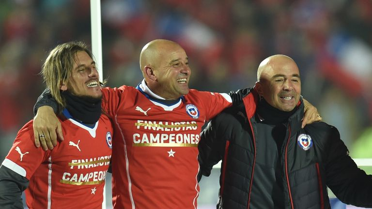 Chile's coach Jorge Sampaoli (R) celebrates with his team after winning the Copa America
