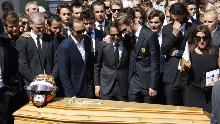 Jean-Eric Vergne (C-R) and fellow driver Brazilian Felipe Massa (C-L) stand with other friends and relatives in front of Jules Bianchi's coffin