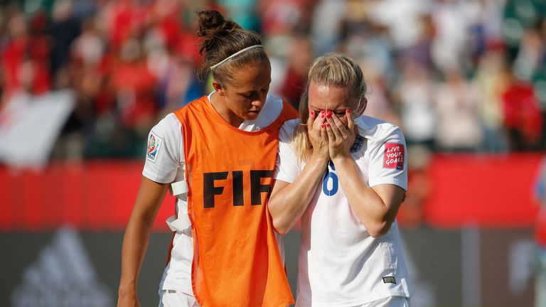 Laura Bassett is comforted by team-mate Jo Potter after England's semi-final defeat at the 2015 World Cup