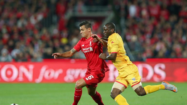 Dejan Lovren of Liverpool and Bruce Djite compete for the ball