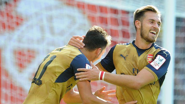 Mesut Ozil celebrates scoring Arsenal's fifth goal with Aaron Ramsey
