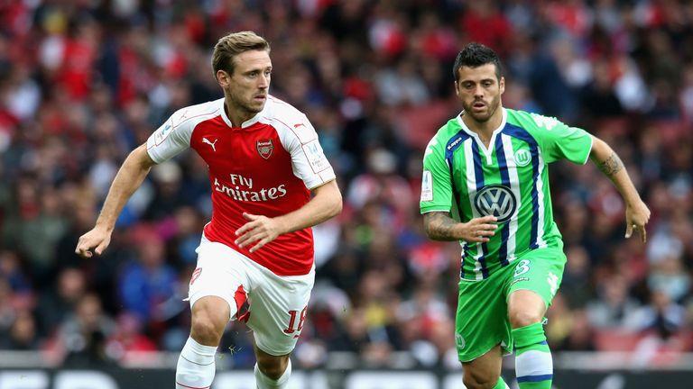 Nacho Monreal of Arsenal is tracked by Wolfsburg's Vieirinha