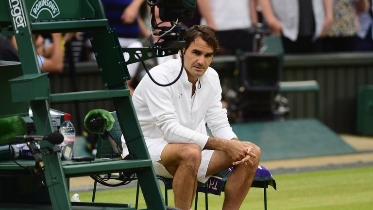 Roger Federer says a rain delay in the third set disrupted him in the Wimbledon final against Novak Djokovic