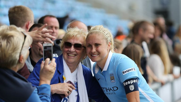 Manchester City and England captain Steph Houghton (right) with fans at the end of the game against Birmingham City Ladies