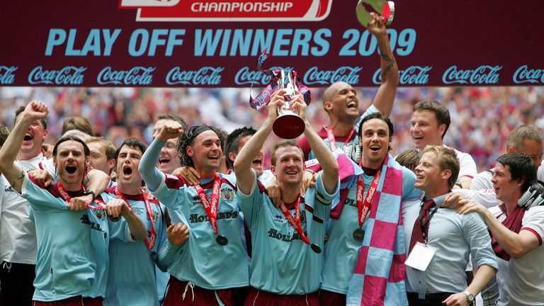 Steven Caldwell holds the Championship play-off trophy aloft after captaining Burnley to victory in 2009