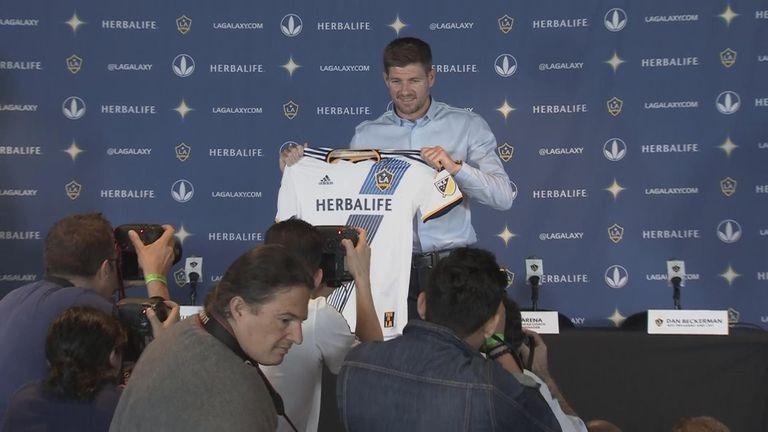 Steven Gerrard poses with his LA Galaxy shirt