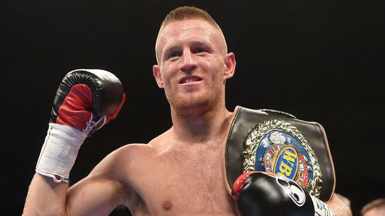 Terry Flanagan celebrates with his world lightweight title