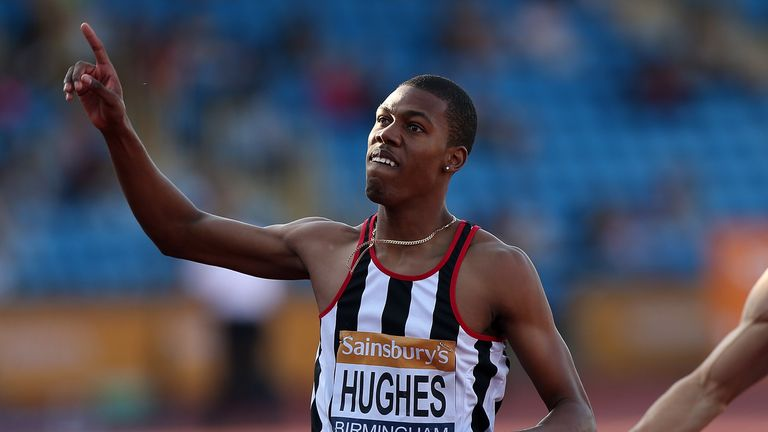 Zharnel Hughes of Great Britain celebrates after winning the men's 200m final