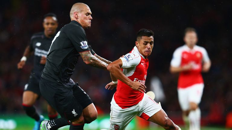 Alexis Sanchez is closed down by Liverpool's Martin Skrtel