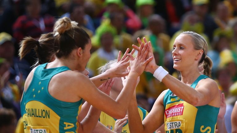 Renae Hallinan (right) of Australia high fives her team-mates