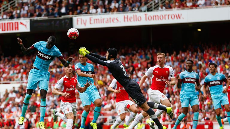 Petr Cech fails to punch the ball clear as Cheikhou Kouyate of heads in the opening goal at the Emirates