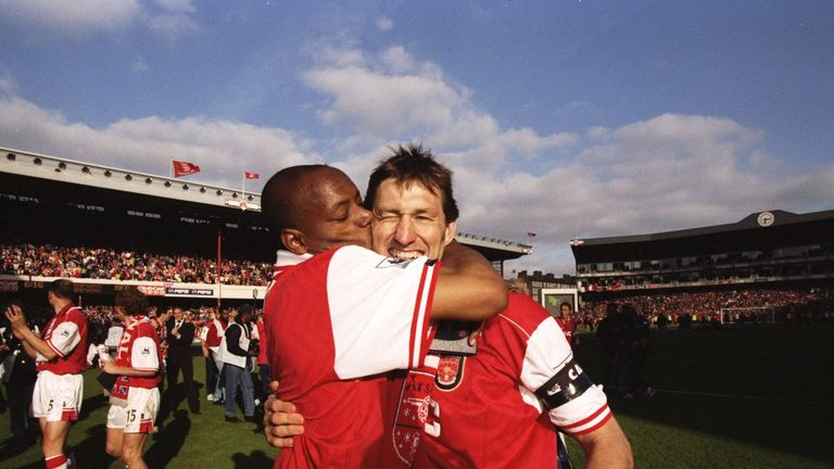 Adams celeberates winning the Premier League title with Ian Wright in 1998