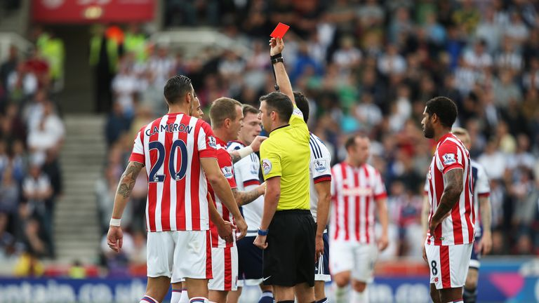 Ibrahim Afellay of Stoke City is shown a red card by referee Michael Oliver