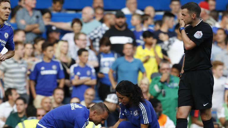 Referee Michael Oliver (right) summoned physio Jon Fearn and club doctor Eva Carneiro on to the pitch to treat Eden Hazard at the player's request