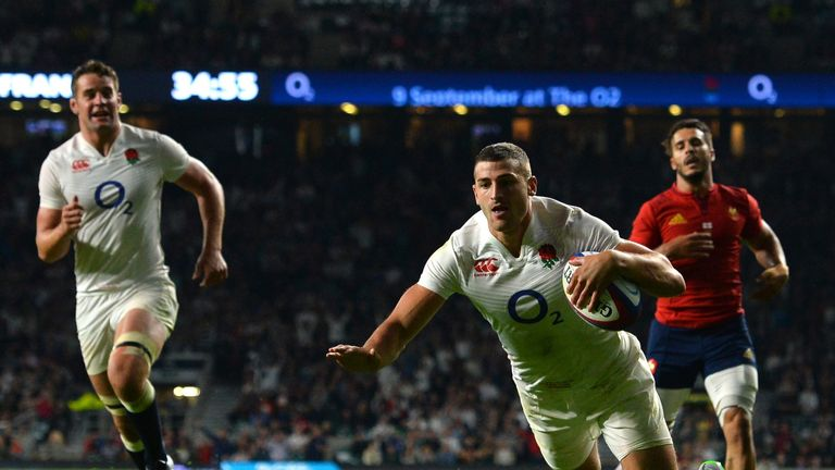 England wing Jonny May scores his side's third try of the game