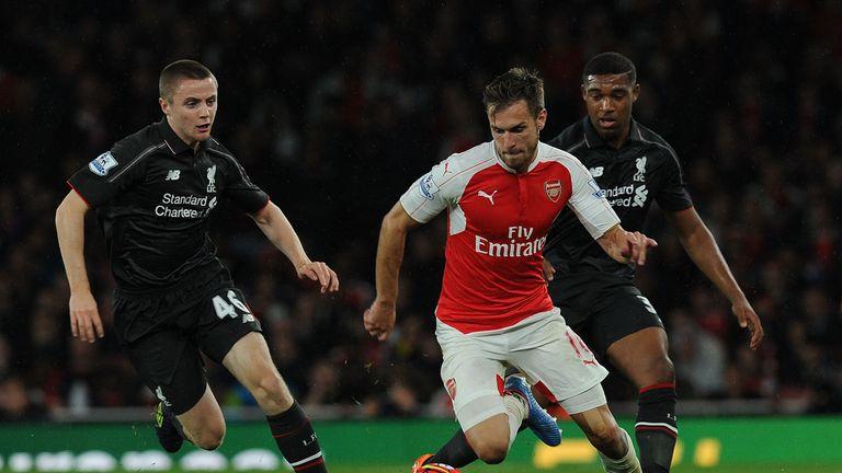 Jordan Rossiter (left) made his Premier League debut for Liverpool against Arsenal