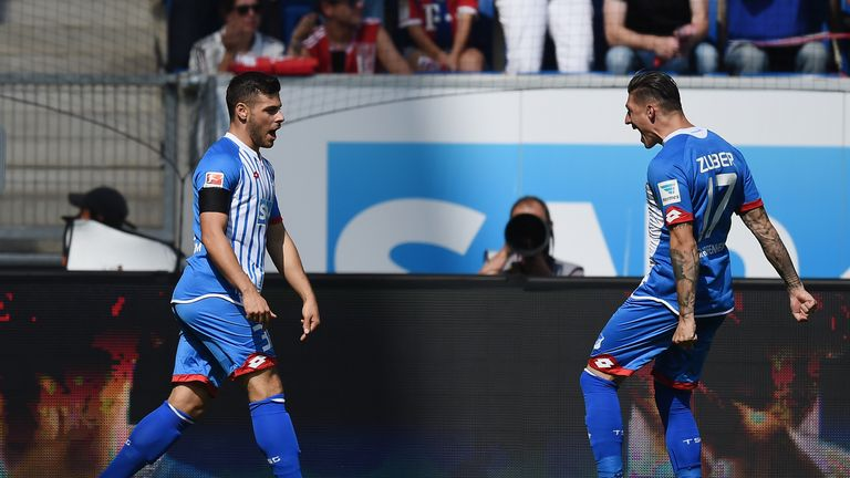 Kevin Volland of Hoffenheim (left) celebrates his record-equaling goal with Steven Zuber (right)