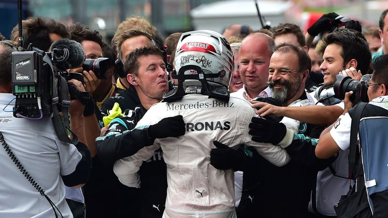 Lewis Hamilton celebrates with his Mercedes crew