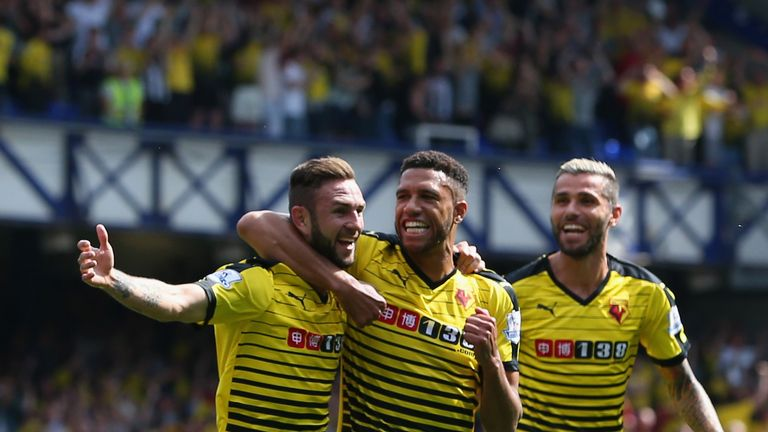 Miguel Layun celebrates scoring Watford's first goal with team-mate Etienne Capoue