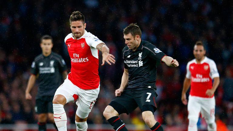 Olivier Giroud and James Milner battle for the ball