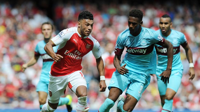 Reece Oxford tracks Arsenal's Alex Oxlade-Chamberlain.