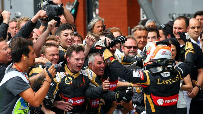 Romain Grosjean celebrates with his Lotus mechanics after finishing third at Spa