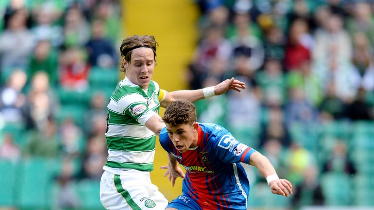 Stefan Johansen (top) is held off by Inverness goal scorer Ryan Christie.