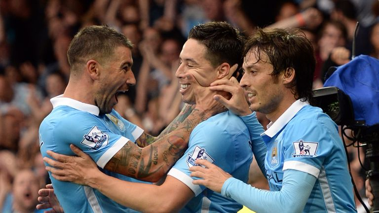 Samir Nasri celebrates with Aleksandar Kolarov and David Silva during City's 2-0 win at Everton