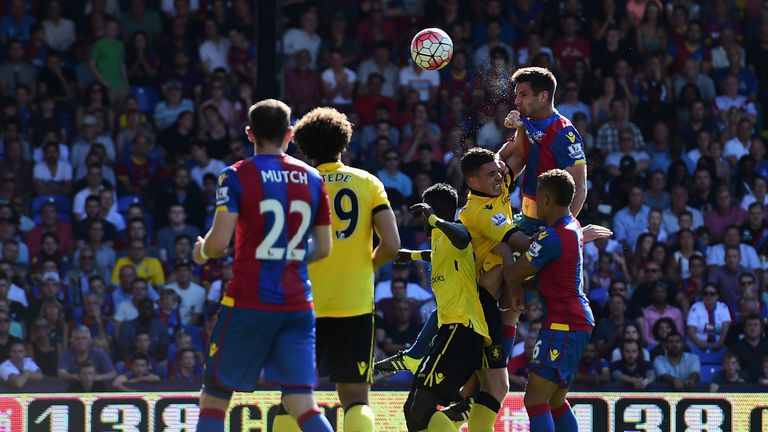 Scott Dann of Crystal Palace heads to score his team's first goal against Aston Villa