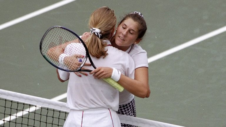 Seles hugs Graf at the net