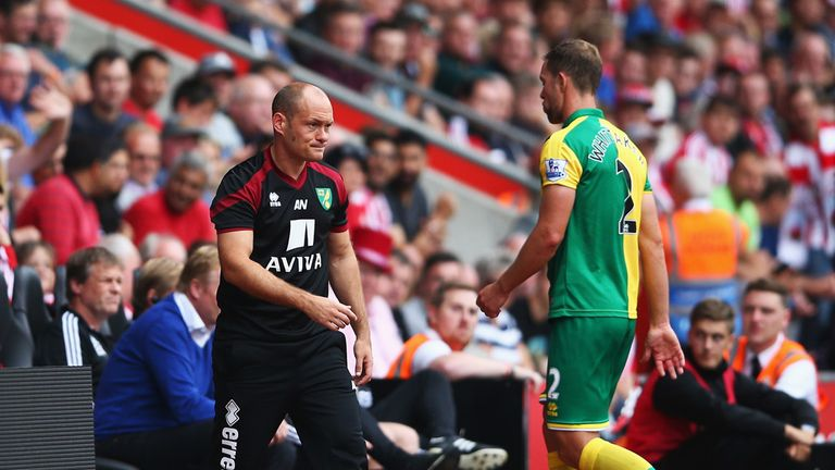 Steven Whittaker leaves the field past Alex Neil after being sent off