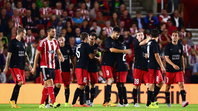 Tim Sparv of Midtjylland is congratulated by team mates after scoring