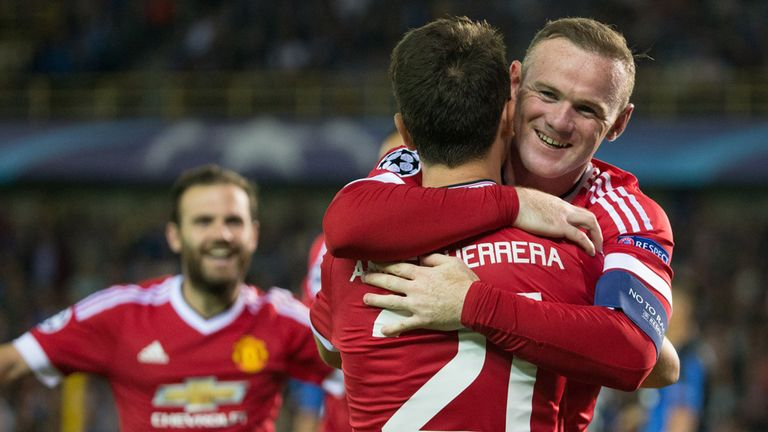 Wayne Rooney celebrates after scoring a hat-trick in United's 4-0 win in Brugge