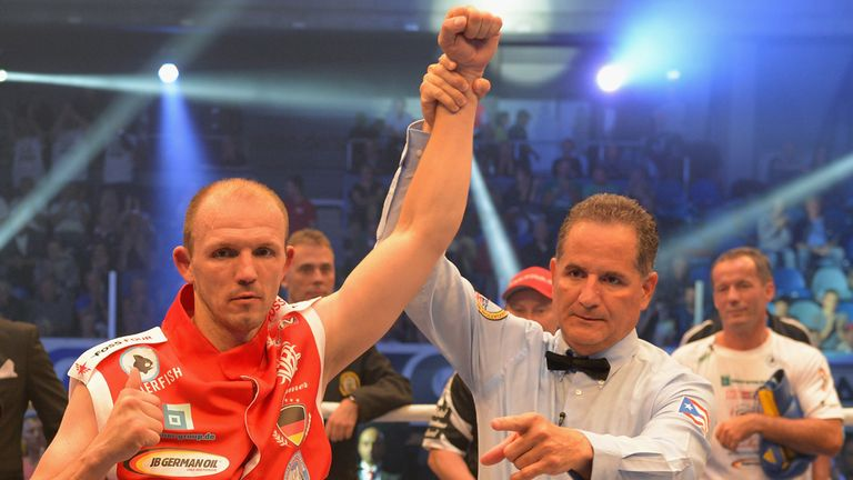 Juergen Braehmer celebrates his victory over Konni Konrad