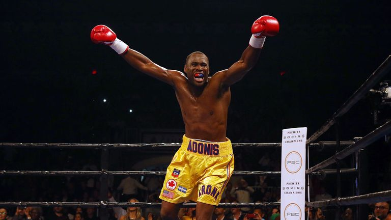 Adonis Stevenson celebrates after defeating Tommy Karpency