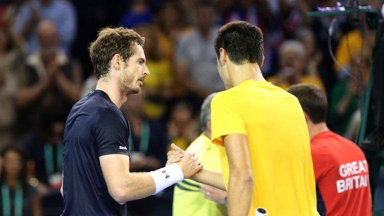 Andy Murray consoles the beaten Bernard Tomic