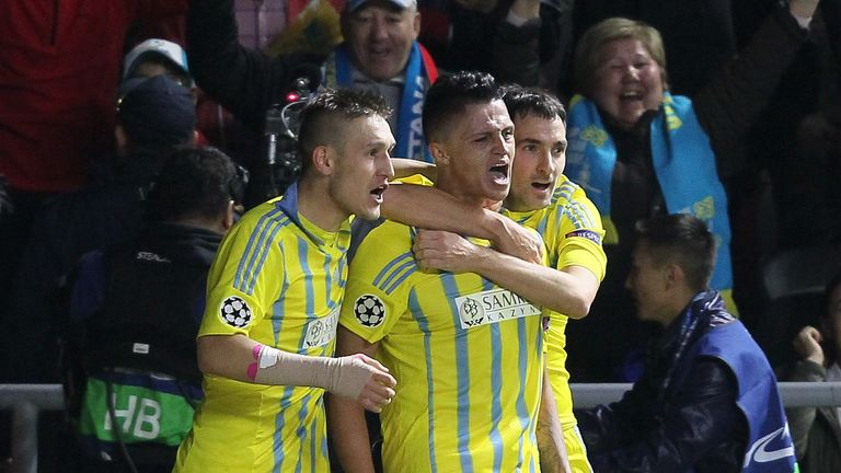 Astana's players celebrate scoring against Galatasaray. Astana became the first team from Kazakhstan to win a Champions League point