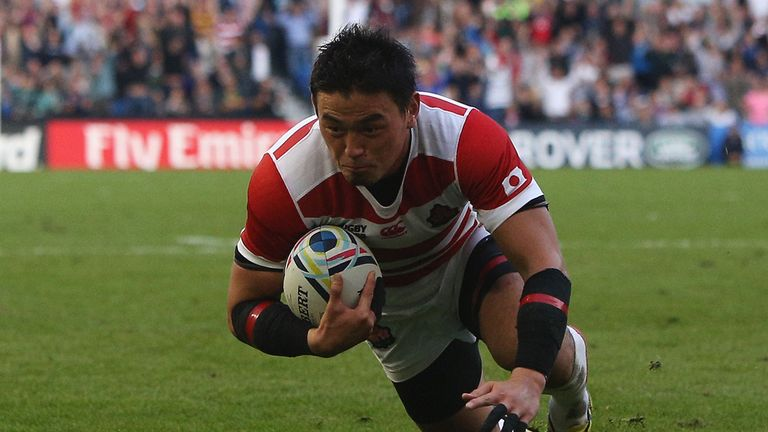 Ayumu Goromaru of Japan dives over the score his team's second try against South Africa