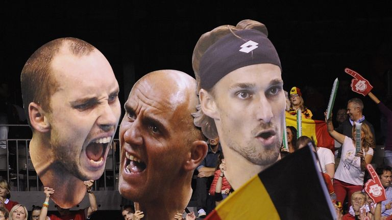 Supporters hold giant pictures of players of the Belgian stars (L-R) Steve Darcis, Ruben Bemelmans, Johan Van Herck