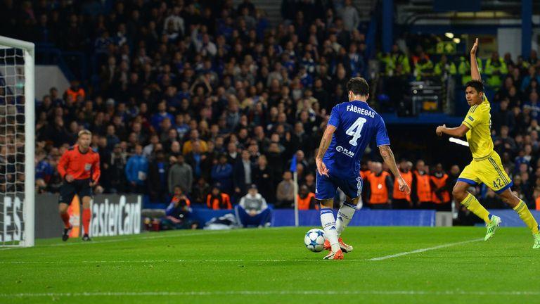 Maccabi Tel Aviv midfielder Dor Peretz calls for offside as Chelsea's Cesc Fabregas scores.