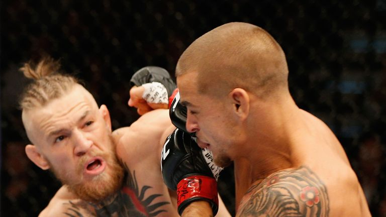 McGregor (L) knocked out Poirier with a left hand